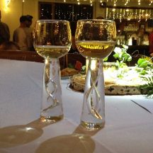 bubbles in stem of wedding goblets reflect gold light