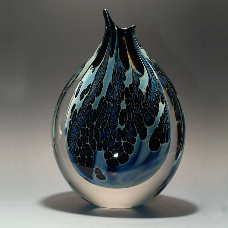 handblown glass vase with patterns like a butterfly wing