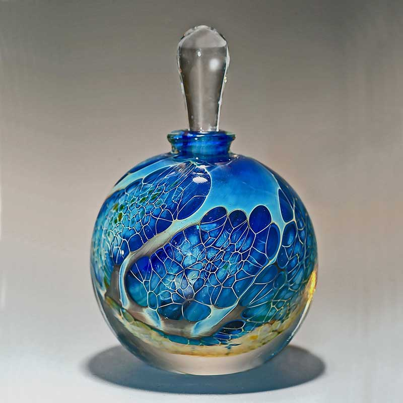 Handblown glass perfume bottle with layers of teal and special silver glass.